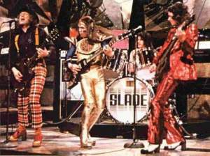 (Ambrose) Slade.  SOurce: http://anythingshouldhappenagain.blogspot.com.au/2013/09/lets-do-show-right-here-glam-in-movies.html